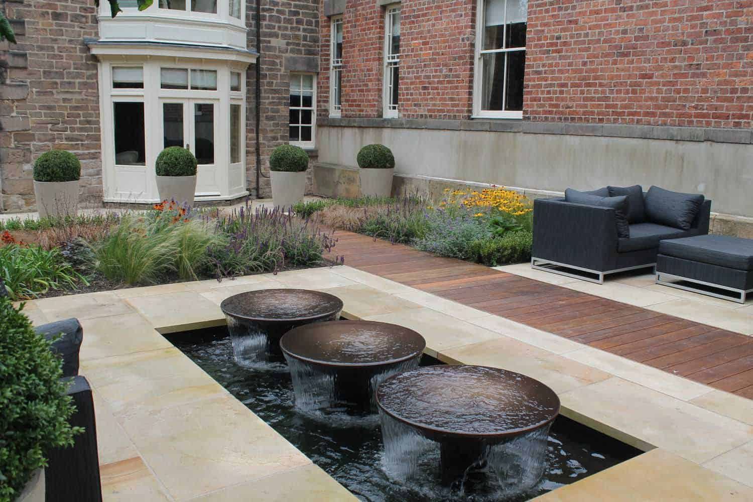 The Grove -bestall--and-co-courtyard garden-yorkshire-modern-planting-dutch-planting Terraced Garden bestall and co Beautiful Planting Planting Design Dry Stone Wall English country classic garden Kat Weatherill