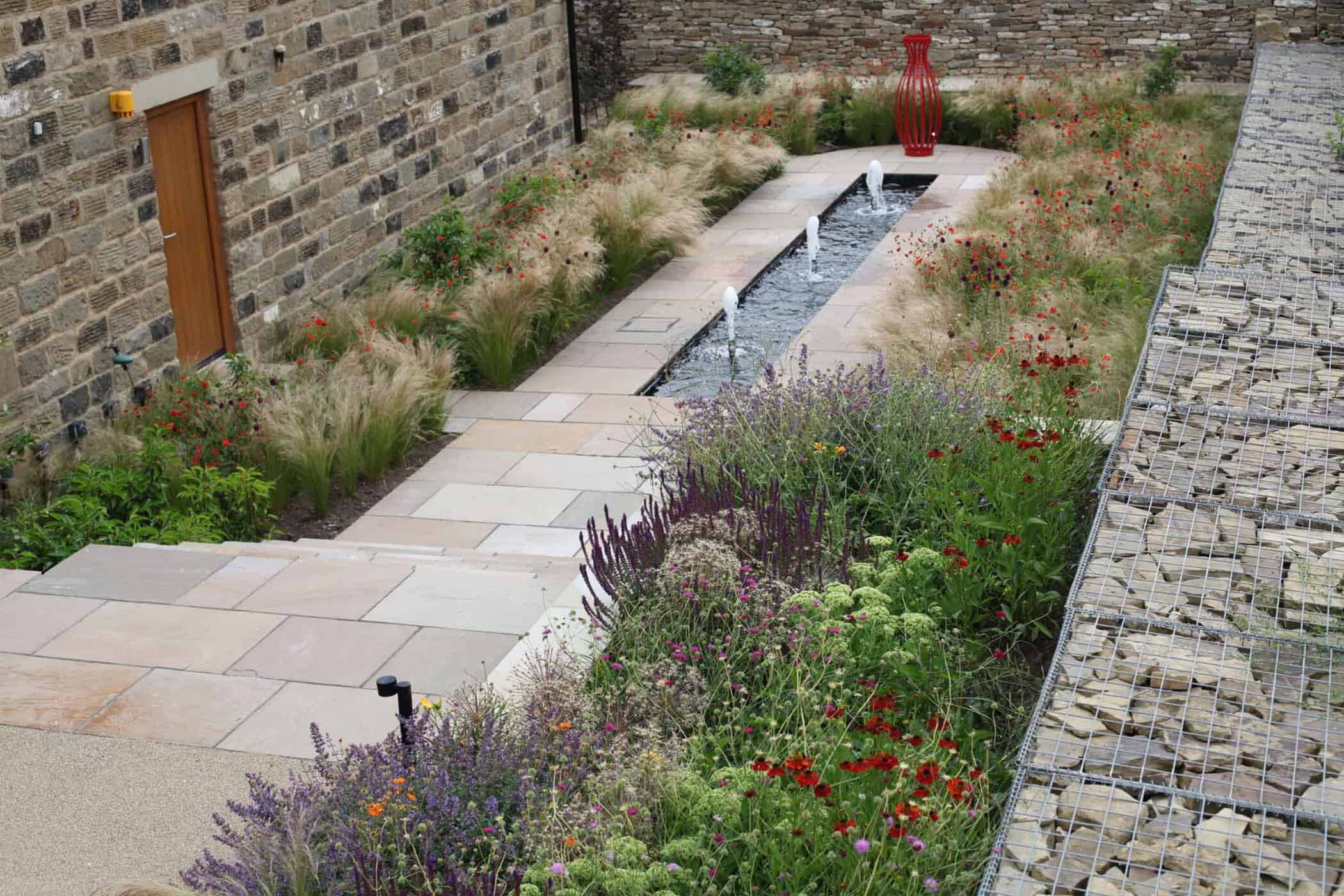 Barn Conversion-bestall and co-Water feature-Grassy Planting-Focal Point