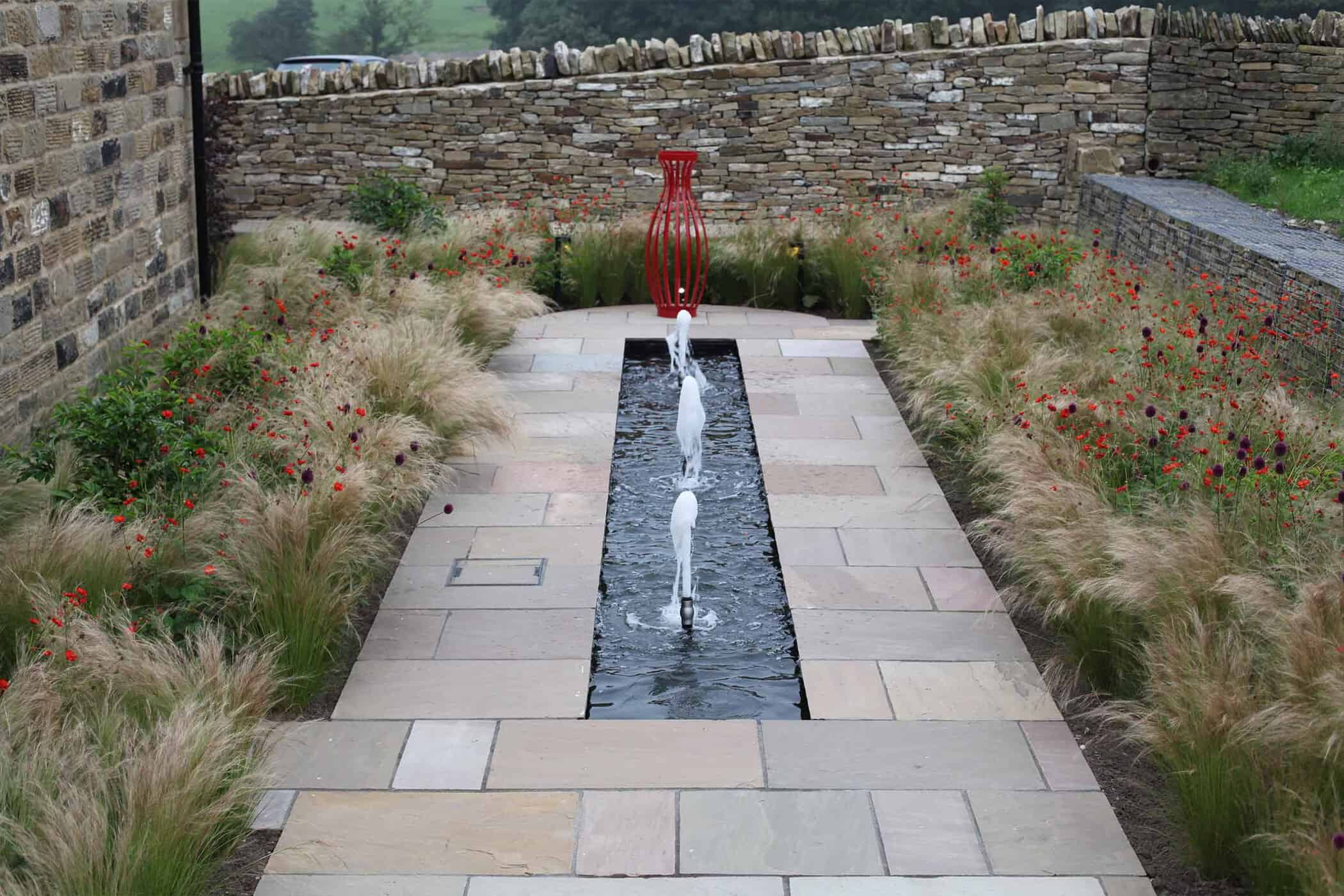 Barn Conversion-bestall and co-Water feature-Grassy Planting -Focal Point