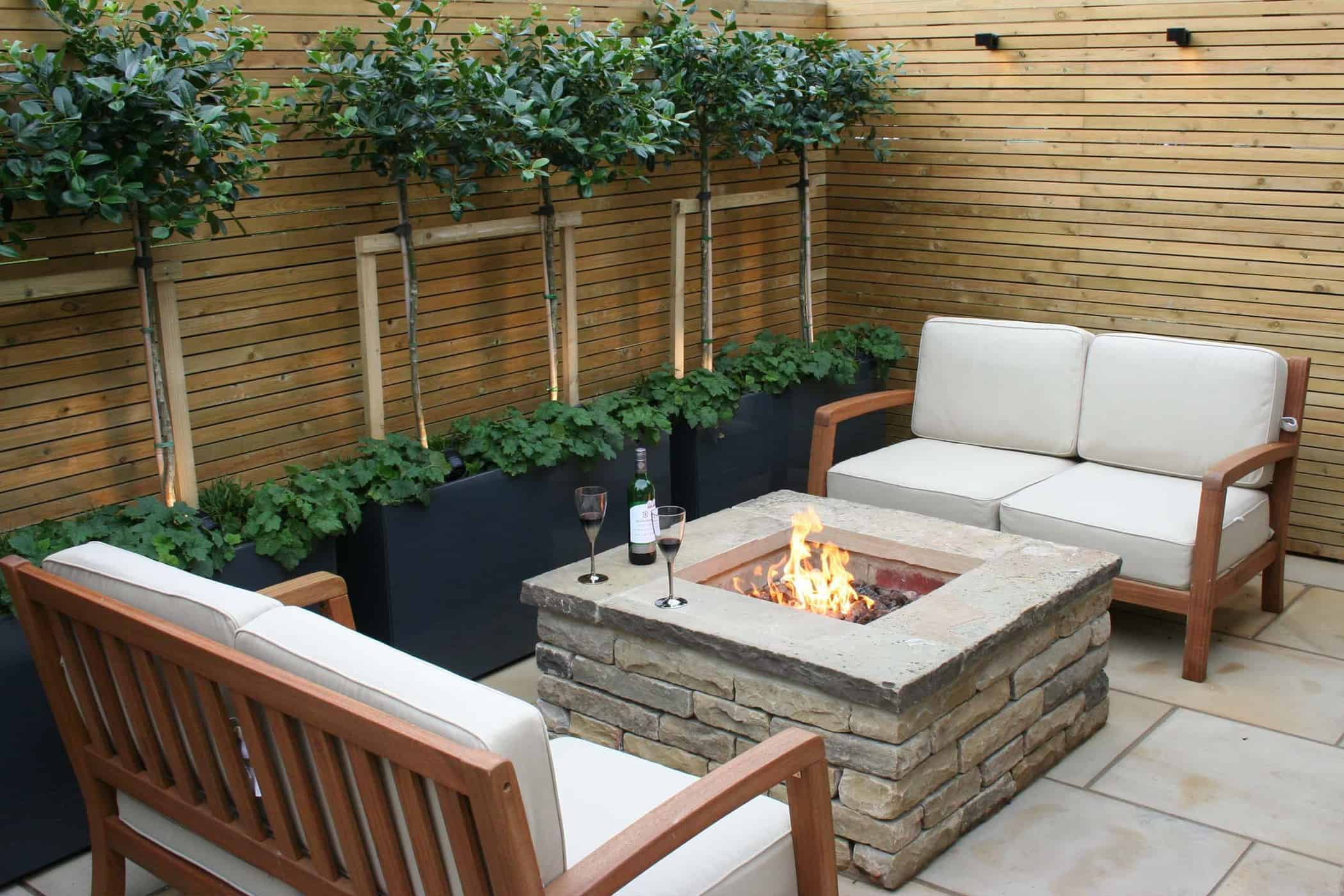 Beautiful Outdoor fire pit in urban courtyard by Bestall & Co