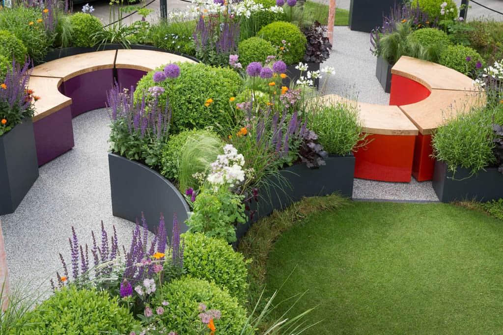 The Sir Simon Milton Foundation Garden, Chelsea Flower Show 2016 - Curved planters - curved benches - grey planters - buxus balls - Bestall & Co - Beautiful planting - fresh gardens - salvia - astrantia - agapanthus - resin bound gravel - chelsea