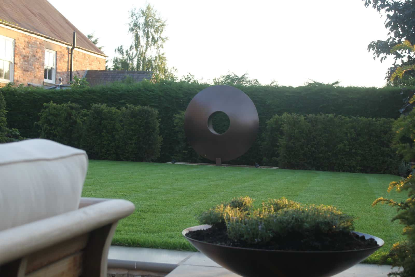 Views - Outdoor Gas Fire Pit - Outdoor sofas - The Bestall Collection - Bestall & Co Landscape Design - Taxus Columns - Sawn Sandstone Paving - Garden Designer Yorkshire - Bowl Planter - Tyme In Planter - Taxus Hedge - Planting Design - Garden Sculpture - Garden Focal Point - Sunken Garden - The Perfect Lawn