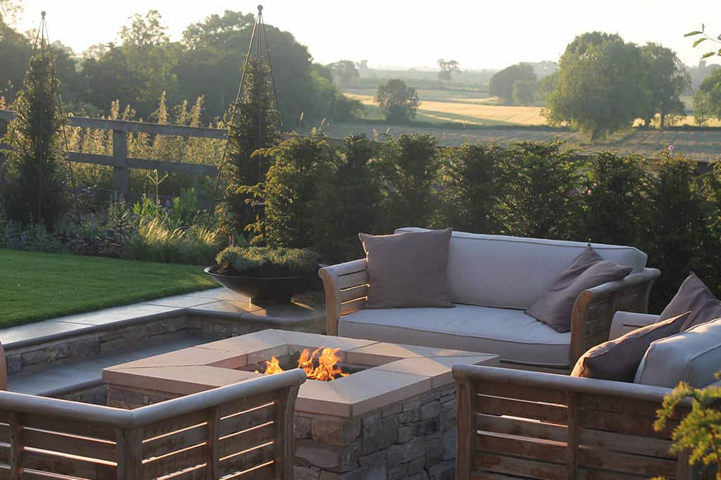 Views - Outdoor Gas Fire Pit - Outdoor sofas - The Bestall Collection - Bestall & Co Landscape Design - Taxus Columns - Sawn Sandstone Paving - Garden Designer Yorkshire - Bowl Planter - Tyme In Planter - Taxus Hedge - Planting Design - Sunken Garden - The Perfect Lawn