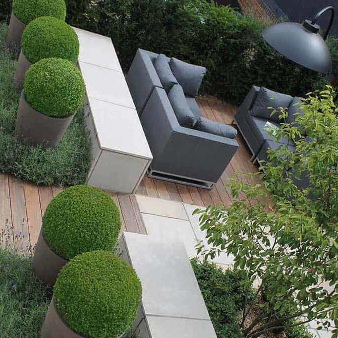 Beautiful outdoor rooms with all weather sofas. Contemporary planting design make for a cosy place to relax